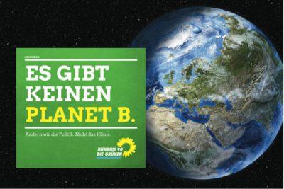 """Erde vom Weltall aus, Schriftzug mit """"Es gibt keinen Planet B."""""""